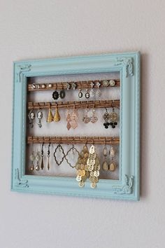 The perfect solution to your messy accessories pile. Turn your jewelry into functional wall art with a framed earring organizer from Creatively Cluttered. This jewelry organizer is made from an upcycled plastic picture frame. The frame measures 10 1/2 x 10 1/2 inches and includes