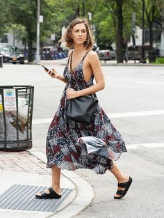 Jessica Alba steps out in a floral midi dress, a crossbody bag, and black Birkenstocks