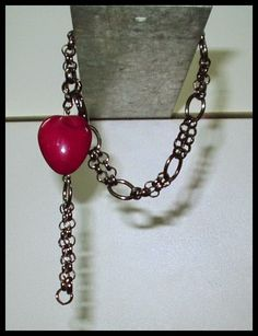 El Secreto Encanto De La Diva:  -   Black bracelet with a nice red heart.