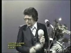 BANDOLERA - HECTOR LAVOE - The band is smoking hot, the bimbo is not! She's good looking she just can't dance!