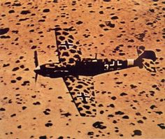 A plane's camouflage well integrate with the surrounding environment. The plane, marked by a well-designed Desert type camouflage, is a German fighter Messerschmitt Bf 109 of the Luftwaffe's. Luftwaffe, Bf 109 K4, Fighter Aircraft, Fighter Jets, Afrika Corps, Focke Wulf, Aircraft Painting, Ww2 Planes, Military Aircraft