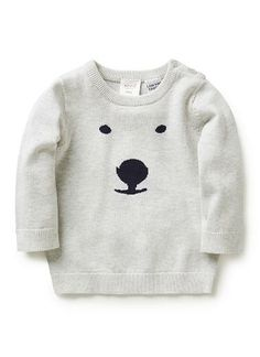 100% Cotton Jumper. Fully fashioned knit, long sleeve jumper. Features front intarsia bear face. Crew neck, with button opening on left shoulder. Available in natural marle.