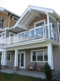 Glass Balcony Design for the deck, exterior paint colors are perfect and i like the grid windows