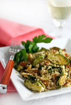 Quinoa with roasted brussels sprouts, leeks and slivered almonds... sounds delicious!