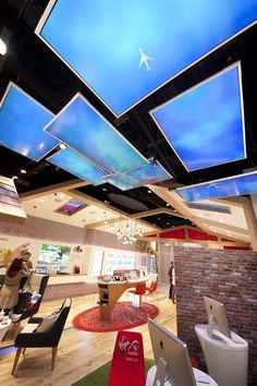 Digital Signage used to create ambience in the faux 'garden' within the store.: