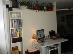 Home Office Space - Crafty wicker baskets with plants give a empty area lots of character and warmth.