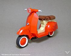Zip around Rome on this lovely red LEGO Vespa