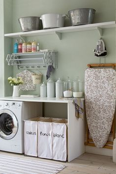 It's amazing what some pretty containers and an MDF worktop can do for a laundry room...
