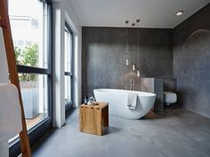 Why using microcement and concrete in the bathroom is a great idea. Concrete Shower, Concrete Bathroom, Bathroom Countertops, Bathroom Flooring, Bathroom Plants, Bathroom Mirrors, Master Bathroom, Contemporary Bathroom Designs, Modern Bathroom