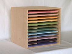 "The 12"" x 12"" paper holder has 12 slots that are 1"" tall for storing your scrapbooking paper and cardstock."