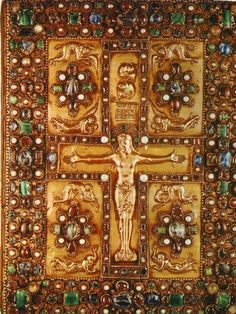 "Front cover of Lindau Gospels; c. 870; gold w/ precious & semi-precious stones; 13 3/4"" x 10 1/2""; Carolingian; Massive acanthus frame & interlaced Cross set with smooth stones (non-faceted). Christus triumphans (Christ is calm & alive), stands on footrest & voluntarily extends his arms. Above his head, the sun & moon hide themselves. Above, 4 angels repose in grief. Beneath, crouches Mary, John, & other Marys. Their clothing drapes across them, showing their heritage as that of Hellenic…"