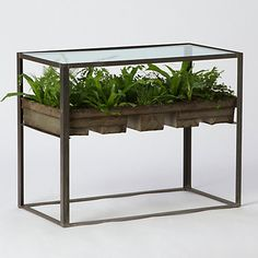 Terrarium side table ~ handmade in the USA, steel and glass, shelved with a rack of reclaimed bakery bread tins