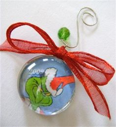 How-to-make-glass-ornaments I recycled old Christmas cards for the images for these. Super simple and I really was pleased with the results. Instead of wrapping wire around them I used ribbon with a knotted loop at the top to hang them.