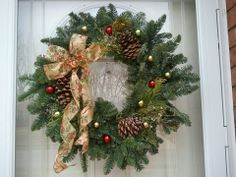 I purchased this evergreen wreath with pine cones from Home Depot for $5, not decorated.  I then purchased decorative and shiny wired ribbon and went onto YouTube to find out how to tie a super easy bow for a wreath.  http://youtu.be/VAf8ZAiRYNI  Miniature ornaments (purchased after Christmas at Target) were randomly placed and applied with a hot glue gun.  All supplies (if you already own a hot glue gun) came to $7!  You won't believe how easy it is to decorate this wreath!!  I just love…