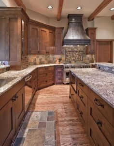 Mission style cabinets, tile in front of sink, wood floors
