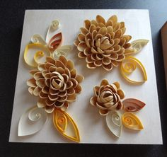Pistachio shell flowers combined with quilling on small canvas