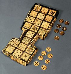 Royal game of the 24 squares of Ur ~ 5th-2nd Mill Bce ~ Geometrical game board and chips with shells, bone, lapis lazuli, and red limestone from a royal cemetery in Ur, Mesopotamia ~ British Museum