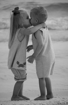YOUNG LOVE. Learning to kiss at a young age!