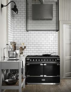 Here's another vintage-style stove paired with a modern range hood, this one from Residence Magazine.