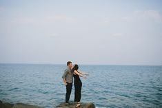 Cute engagement shoot beyond the sea. Photo by Megan Saul Photography