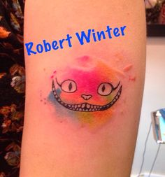 Watercolor Cheshire Cat Tattoo by Robert Winter