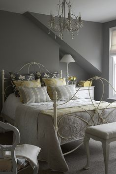 Dark walls w white paintwork & all white bedding. Dark curtains with bronze accents & light voils behind. Bronze picture frames & bronze or copper chandelier