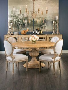 Venetian Holiday: An elegant handcrafted design white sustainable mango wood, this dining table subtly sophisticated. Magnolia Round Dining Table, $1,299. Benjamin Moore Blue Note