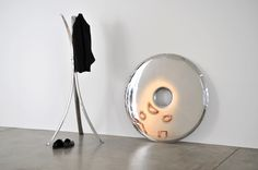 The RONDO mirror is made of stainless steel polished to high gloss. It is produced in two sizes with the diameter of 75 and 120 cm. Its polished surface is perfectly reflecting the light and other objects placed in the same room or hall. Depending on the Rondo´s arrangement, either by hanging it or leaning at the wall, the mirror can change the perception of the surroundings.