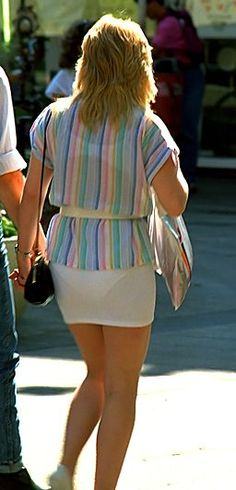 Photo from the mid 1980s featuring a women wearing a tight mini skirt with visible panty line - this was acceptable in the 80s!
