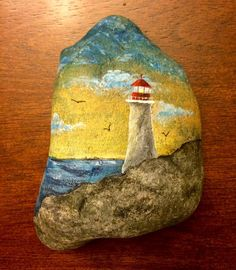 Lighthouse #paintedrocks #stoneart #spiritinstones #rockpainting #lighthousepainting #art