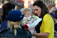 Token of appreciation: Kate was handed a beautiful bouquet of flowers, one of many she wil... http://dailym.ai/RnIl5L#i-a9cc0e74