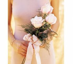 """Trending: """"Depending on the dress, the mother of the bride may choose to carry a small bouquet of flowers during the wedding & into the reception ... or she may still choose to wear the flowers on her wrist or as a corsage.     She could also choose just to carry a single flower such as a rose.     The mother of the bride dress will dictate what's best for her as well as her own personal style."""""""