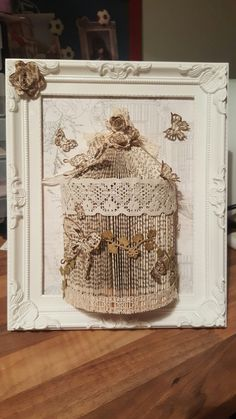Handmade shabby chic birdcage book folding in a picture frame