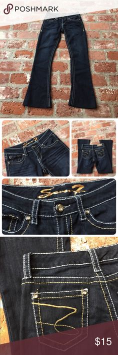 Seven7 size 28 tulip jeans Fun jeans with lots of bling!  Very dark blue wash almost appears black in different light. Measurements:rise 8 inches, waist 31 inches, rise 31 inches. Ankles are hemmed but can be made higher or lower. See last picture. Lots of fun details! Seven7 Jeans
