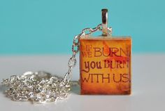 "Hunger Games Pendant ""If We Burn You Burn With Us"". $6.95, via Etsy."