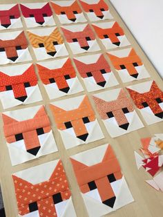 Fancy Fox quilt in progress ~ Think I would intersperse the fox heads with plain blocks.
