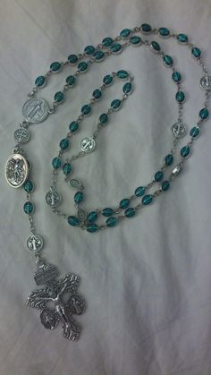 From the Spiritual Warfare collection: the Green Miraculous Medal Rosary. The…