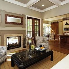 River Forest Family Room with twilight fireplace and double doors to the covered porch built by Homes by Dickerson Cabin Fireplace, Fireplace Seating, Fireplace Bookshelves, Small Fireplace, Fireplace Remodel, Living Room With Fireplace, Fireplace Surrounds, Fireplace Trim, Granite Fireplace