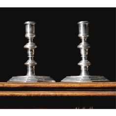 A fine pair of William III Britannia standard silver candlesticks, Pierre Harache I, London, 1698