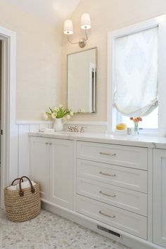 Master bathroom remodel.  Marble hex floor tile, custom vanity, vendome double sconces, quadrille fabric relaxed roman shade.