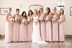 Bridesmaids in mis-matched blush colored floor length crinkle chiffon gowns (by Watters)