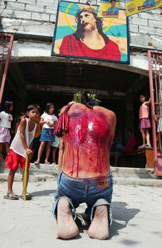 Self-Flagellation  A penitent prays at a chapel after performing self flagellation during an annual ritual on Good Friday, April 9, 2004 in Cutud, San Fernando, Philippines. Since the 1950's, a dozen or so penitents participate in an annual re-enactment of Christ's crucifixion, a practice that the Catholic Church frowns upon. (David Greedy, Getty Images)