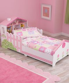 Dollhouse Toddler Bed Low to the ground for easy access and adorned with detailed dollhouse artwork, this toddler bed is ideal for transitioning out of the crib. A sturdy construction with bed rails keeps kids safe while sleeping and integrated storage means space savings.