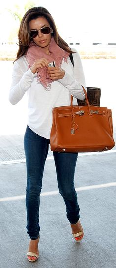 Eva Longoria arrives at JFK Airport in NYC.  April 5, 2012. Casual