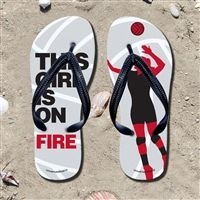 This Girl Is On Fire Flip Flops - Kick back after a volleyball game with these great flip flops! Fun and functional flip flops for all volleyball players and fans.