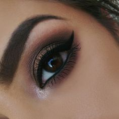 Oh-so-glam, this sultry look by Alyssa K uses Makeup Geek's signature eyeshadows in Bada Bing, Bitten, Burlesque, Hipster, Latte, Mocha, and Barcelona Beach.
