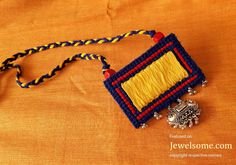 embroidered-necklace-in-yellow-and-brown