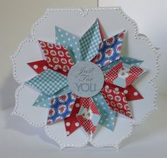 Card designed by Julie Hickey using our Paper Artistry kit.  Kitsch double sided papers, Kitsch die cuts and double sided Candi onto flower shaped card blank.