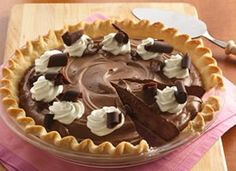 French Silk Chocolate Pie: Crust  1 Pillsbury® refrigerated pie crust (from 15-oz box), softened as directed on box  *Filling: 3 oz Hershey's® unsweetened chocolate, cut into pieces, 1 cup LAND O LAKES® Butter, softened (do not use margarine) 1 cup sugar, 1/2 teaspoon vanilla, 4 pasteurized eggs or 1 cup fat-free cholesterol-free egg product  *Topping:   1/2 cup sweetened whipped cream  Chocolate curls, if desired [Directions below]