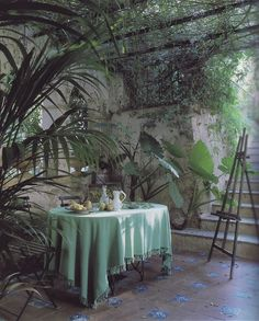 lovely lush pale greens, palms & artists easel